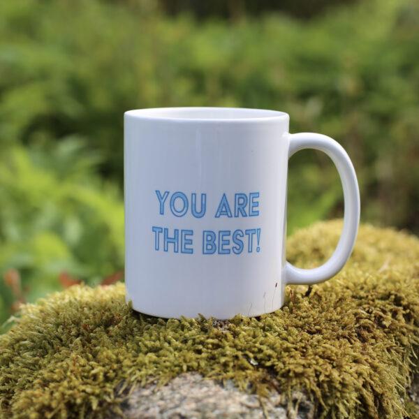 Porslinmugg med eget tryck. Text: You are the best (i blått)